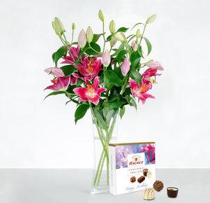 5 pinke Lilien mit Hachez Pralinen