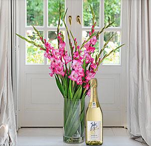 Pinkfarbene Gladiolen mit Sekt Jules Mumm