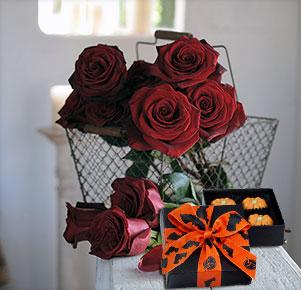 10 schwarze Rosen mit Kürbispralinen
