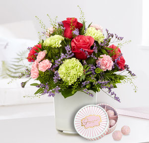 Blumenstrauß Schön, dass es Dich gibt mit 6er pink Champagne Truffes in Blau, Rosa und Pink