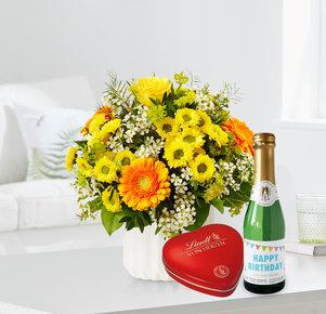 Blumenstrauß Geburtstagsüberraschung mit Lindt Herz und Geburtstagssekt in Weiss, Gelb, Orange und Grün