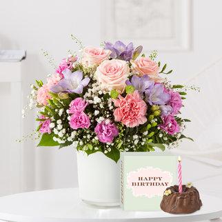 Blumenkuss mit Geburtstagsküchlein mit Kerze