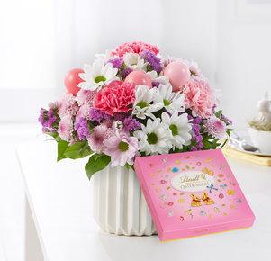 Blumenstrauß Osterbote mit Lindt Pralinen frohe Ostern in Weiss, Rosa und Pink