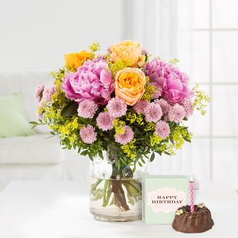 Blumenmeer mit Geburtstagsküchlein mit Kerze