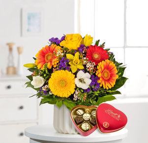Blumenstrauß Farbenglück M mit Lindt Herz in Rot, Gelb, Orange und Lila
