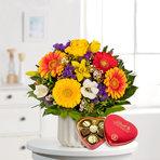 Blumenstrauß  Farbenglück Größe M mit Lindt Herz