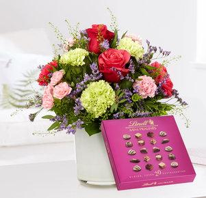 Blumenstrauß Schön, dass es dich gibt mit Lindt Mini Pralinés in Rosa, Pink, Creme und Lila